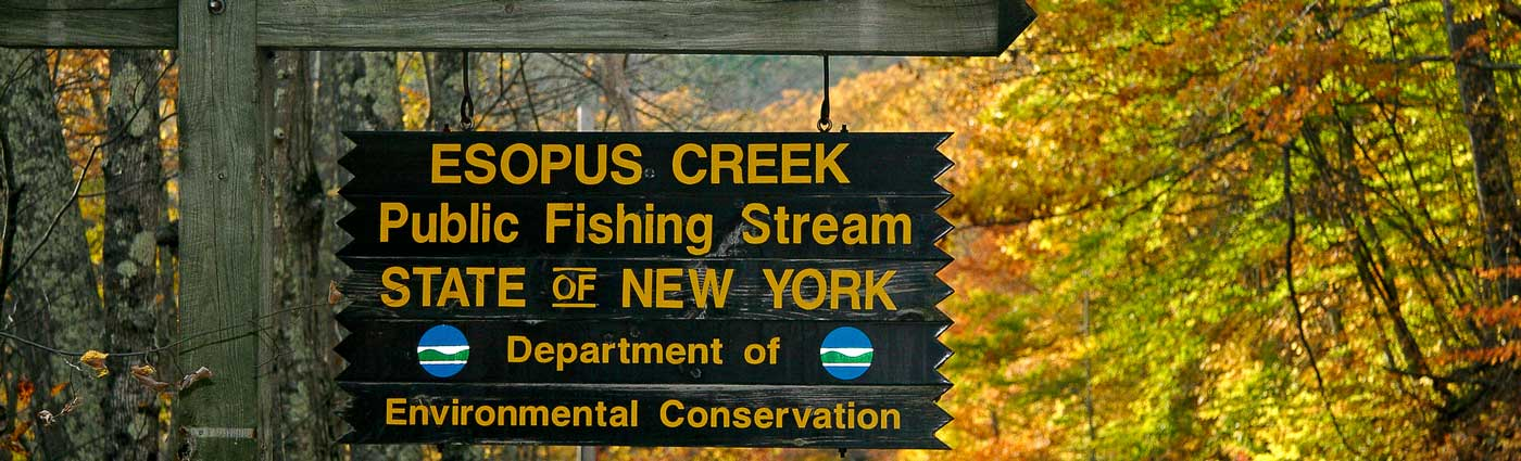 fishing access sign on stream